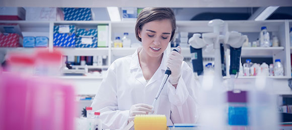 pretty-science-student-using-pipette-000056078252_580px
