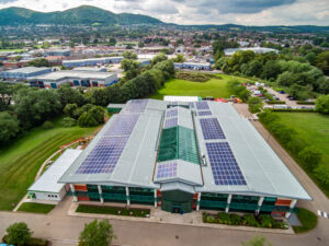 Solar roof at malvern UK site, showing company in front and malvern hills in the background