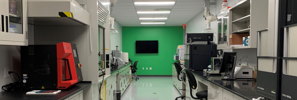 Houston lab facing green wall wide